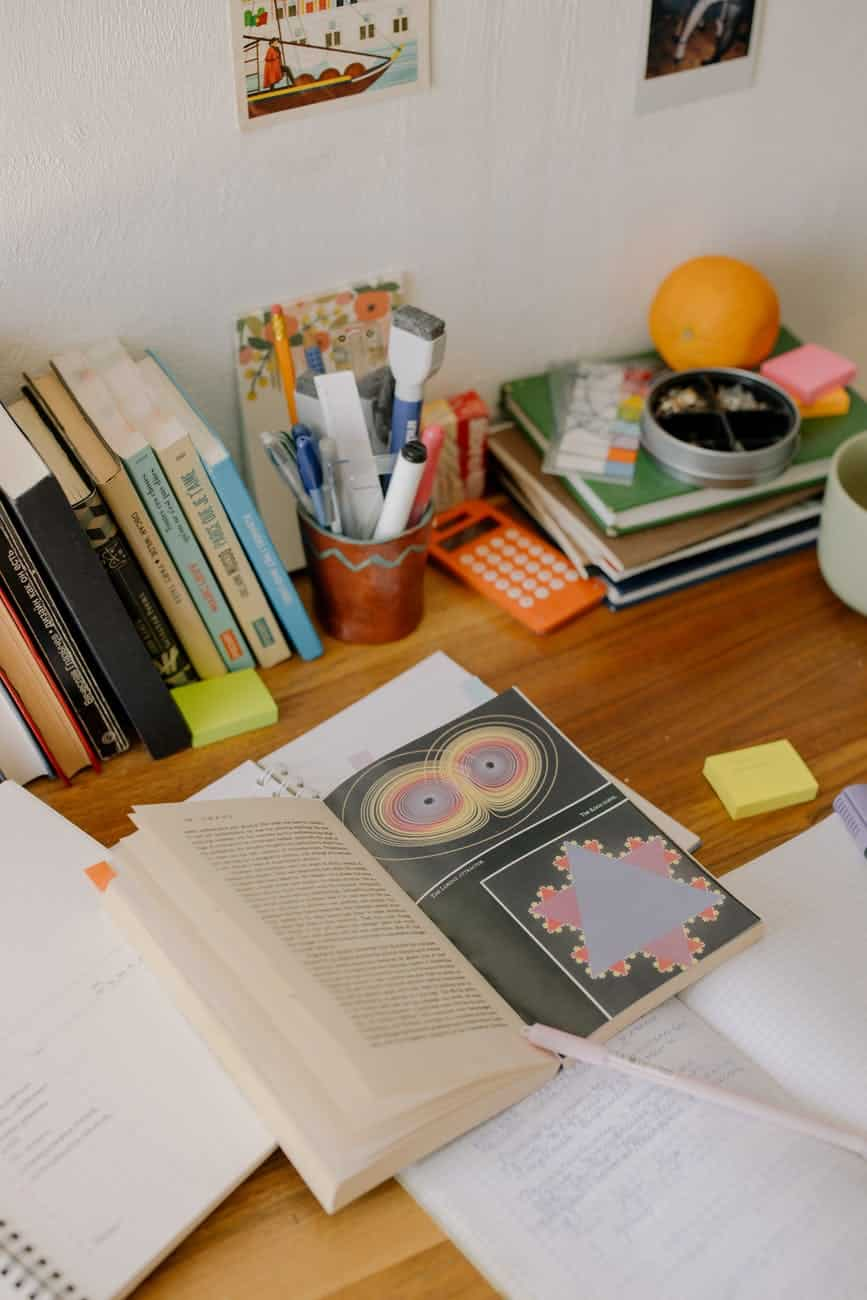books and books on brown wooden table